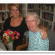 Anna Roeschley (l), former WATER Staff, embraces the late Carol Scinto, WATER's longtime beloved editor