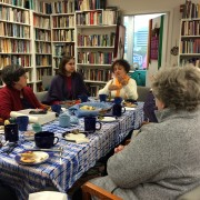 The WATER community hosts Clarita Luz Ajo Lázaro (end of table) for coffee, tea, and lively conversation