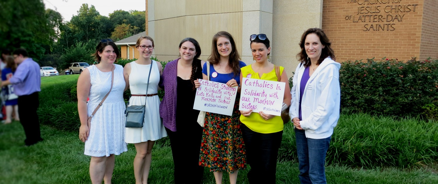Representatives of WATER, Women's Ordination Conference, and Catholics for Choice stand in solidarity with Kate Kelly and Ordain Women. From Left to Right:  Katie Breslin of Catholics for Choice, Ciara Chivers and Cathy Jaskey of WATER, Kate Conmy, Erin Hanna, and Jeannette Mulherin of Women's Ordination Conference.